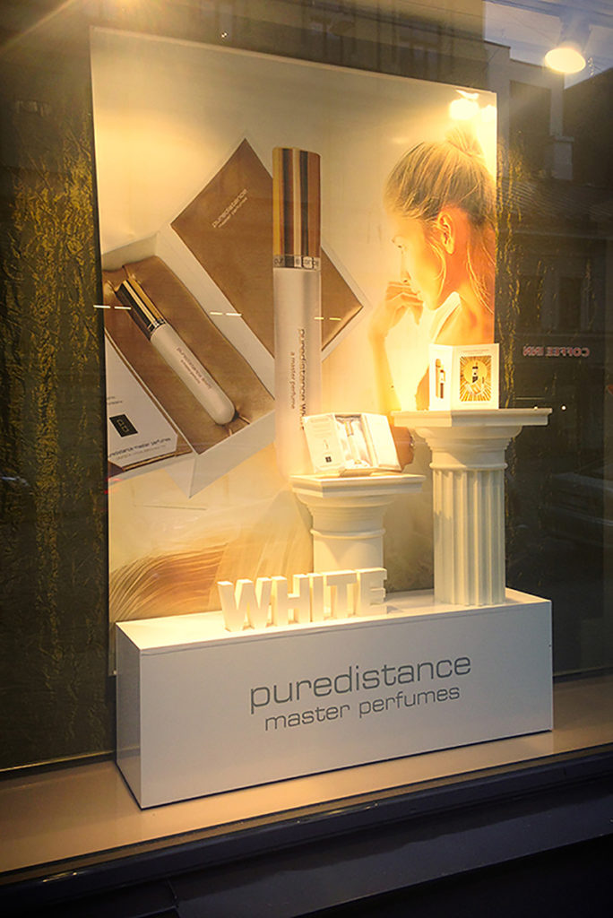 Puredistance White Perfume beautifully displayed in the window of a perfumery