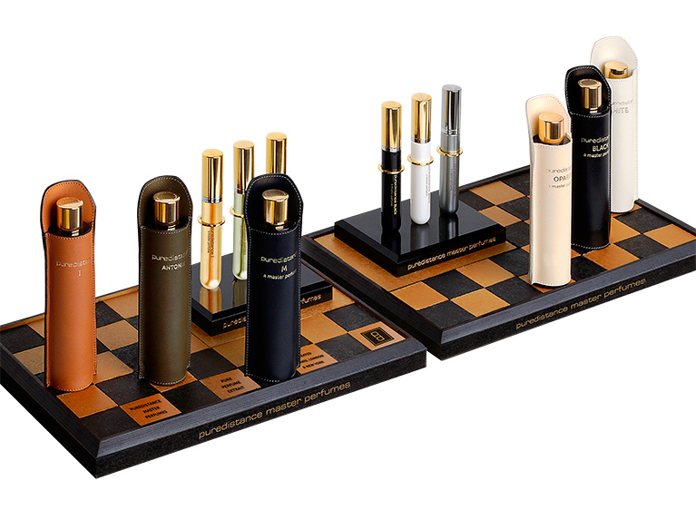 Puredistance Master Perfume Collection displayed on a chessboard display an inhouse designed accessory