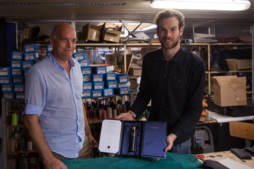 Guy Reyne with his son, holding Puredistance BLACK
